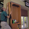 adhere a prefinished plywood skin to the sides of the cabinets