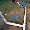 Run pipe from the T-fitting along the trench