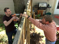 roger cook and homeowner putting up a fence