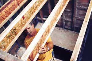 Tom Silva stiffening i-joists before installing a floor