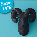 black faux taxidermy ram head hanging from a blue wall with text in the upper corner that says 15 percent off