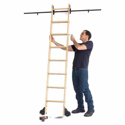 man building a library-style ladder