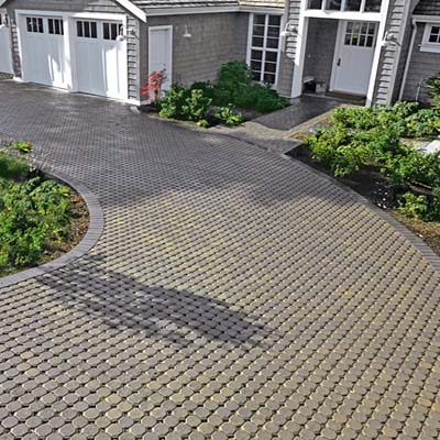 concrete pavers designed with voids to be filled with quick-draining gravel