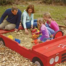 race car shaped sandbox for kids and adults to build