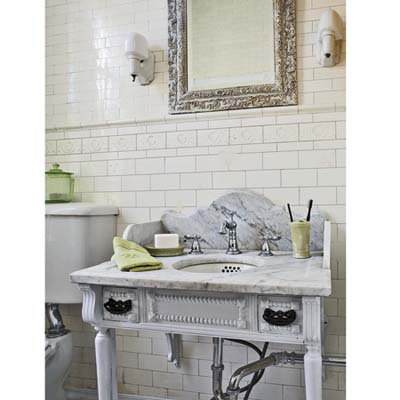 bathroom with marble sink, and glass shades