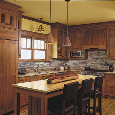 kitchen is completed with oak cabinets with matching panels 
