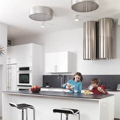 open-plan-kitchen with reflective surfaces and bright lights