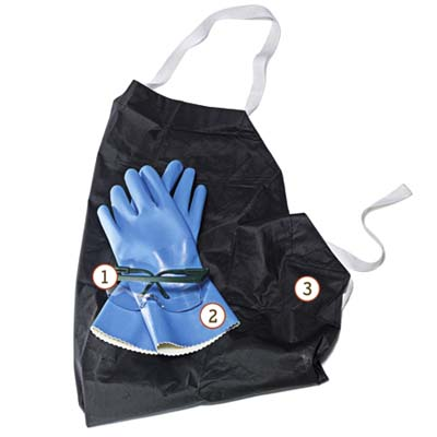 safety goggles and PVC-coated gloves on top of a black rubber apron