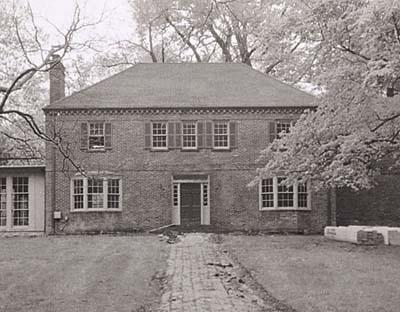1930s brick house with nondescript entry