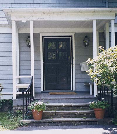 flat-roofed entry porch built with undersized framing lumber