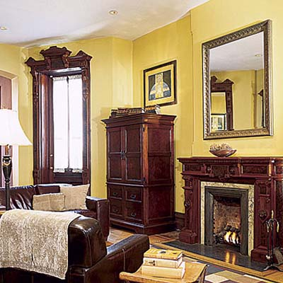 fireplace and golden-yellow walls