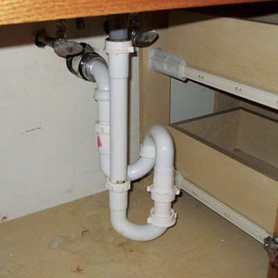 piping under the kitchen cabinets