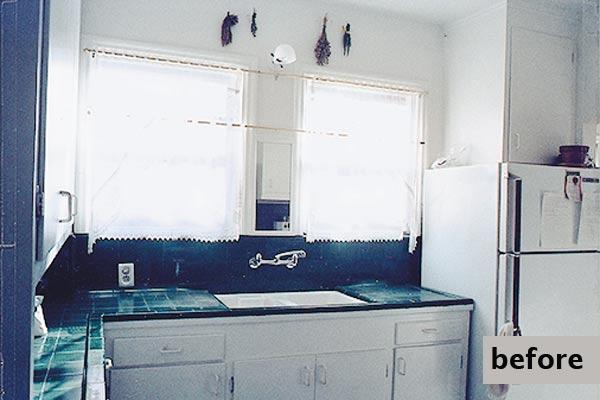 old kitchen had plain white tiles and was cramped