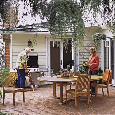 homeowners relax on the patio
