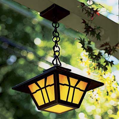 Bronze light fixture with amber glass shades