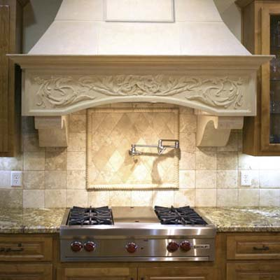 an installed Travertine Kitchen Hood from Euro Cast design