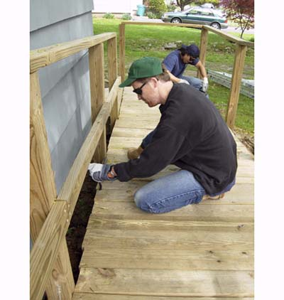 Timothy Dahl and John Taylor repair wheelchair ramp