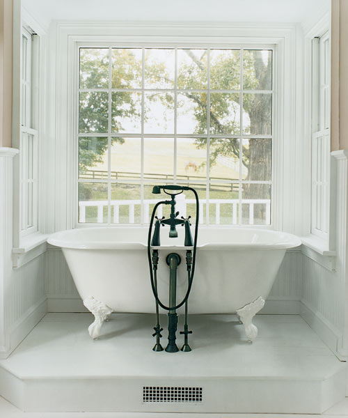 A new tub alcove created from an existing wooden deck bath remodel