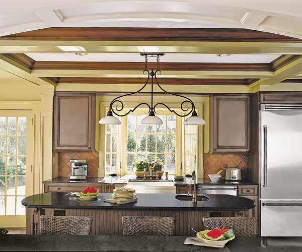 breakfast bar and island in Tudor Revival kitchen before and after