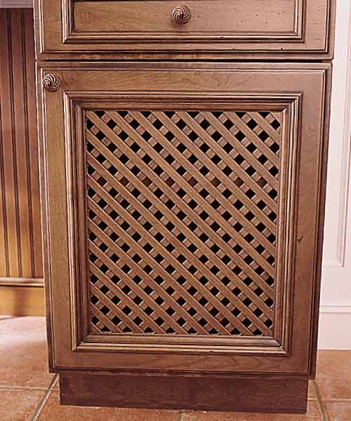 Kitchen tudor revival style after remodel with latticework cabinet panel