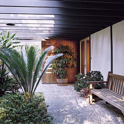 Windowed walkway with pocket doors and trelliswork overhead