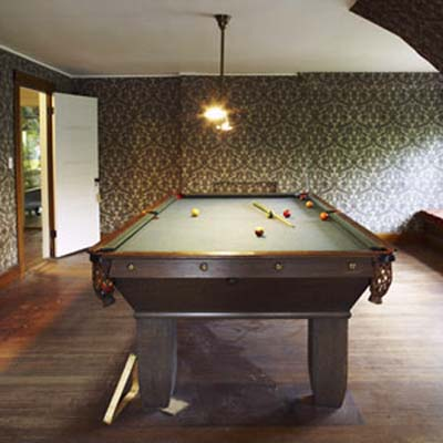 Billiards table with light fixture