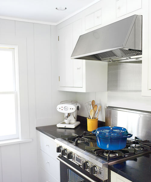 new range with hood helps create space in the new galley kitchen design