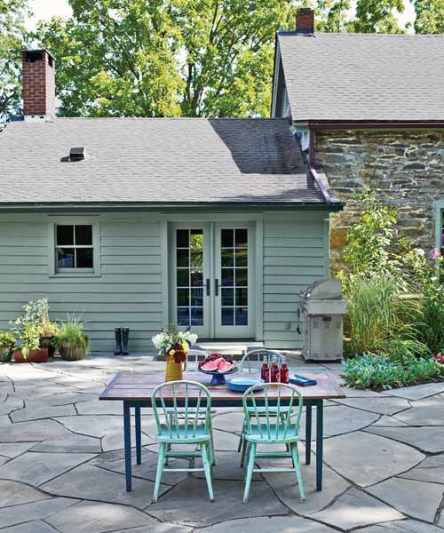 broken-bluestone patio with outdoor table and chairs