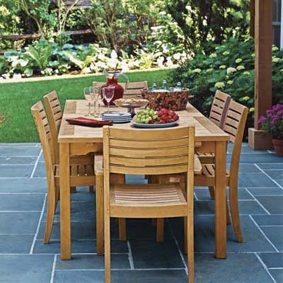 teak wood patio furniture on slate tile patio