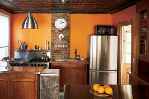 small orange kitchen remodel with stainless steel countertops and original hutch