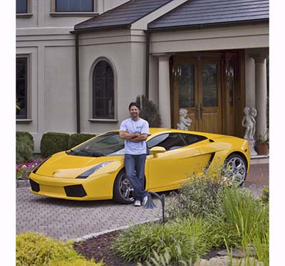 Michael Andretti at home with his Lamborghini