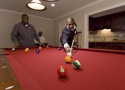 NBA star Chris Paul shoots pool