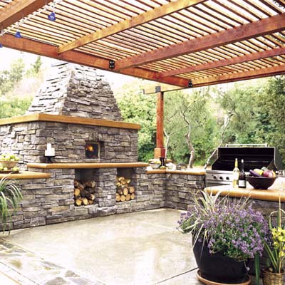 Pizza oven and pergola in outdoor kitchen