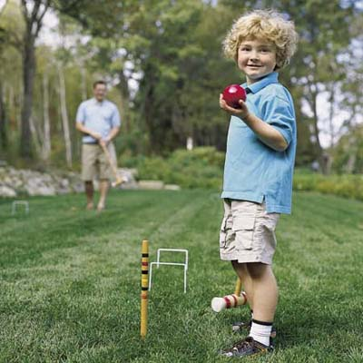 boy holding croquet ball