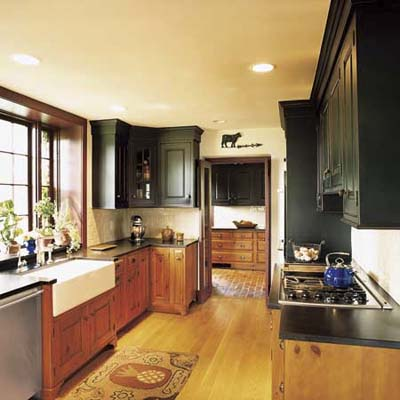 kitchen with pine and cherry cabinetry, new hardwood plank floor, honed black-granite countertops at Ravenroyd