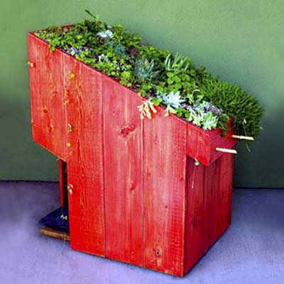 doghouse with a green roof on top