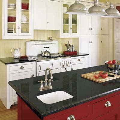 kitchen with Shaker-style cabinets, 1950s Chambers gas range, and granite countertops