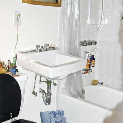 the original sink area before getting a bath-vanity revamp