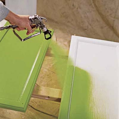 Spray The Paint On How To Paint Kitchen Cabinets This Old House