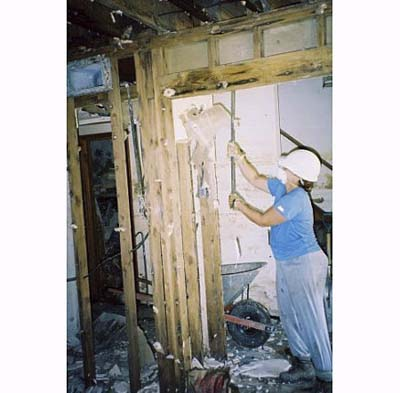 gutting a Katrina-damaged house in New Orleans