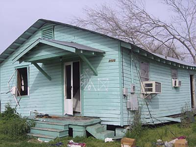 house marked by post-Katrina search crews