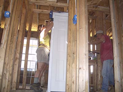 framing an exterior door at the Musicians Village in New Orleans