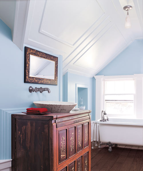 panel molding adds old-house charm in attic bathroom with vanity furniture-type sink