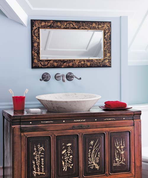 antique chest and a marble vessel sink