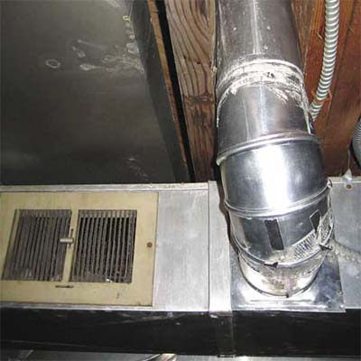 clothes dryer venting into the hot air supply duct