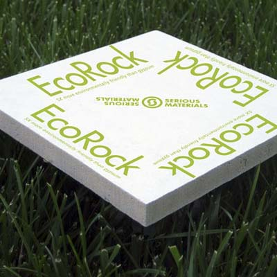 packaged EcoRock gypsum-free drywall sitting on top of blades of grass