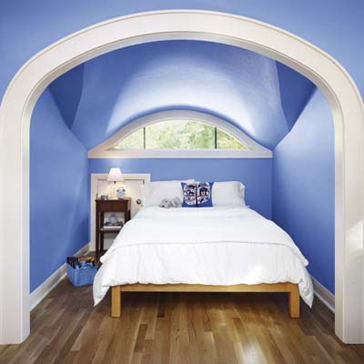 upstairs bedroom converted from attic space of cottage remodel in Austin, TX