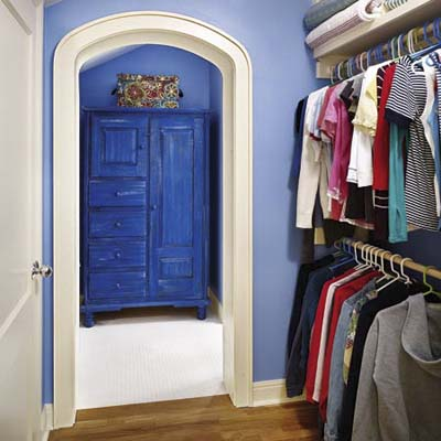 walk-in closet converted from attic space of cottage remodel in Austin, TX