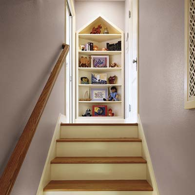 attic stairs leading to a built-in bookcase from a cottage remodel in Austin, TX