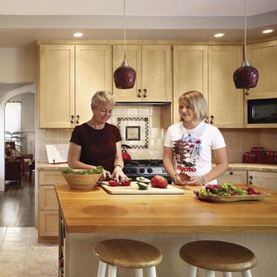remodeled kitchen island with homeowner Anne Lyon and daughter Molly from a cottage remodel in Austin, TX
